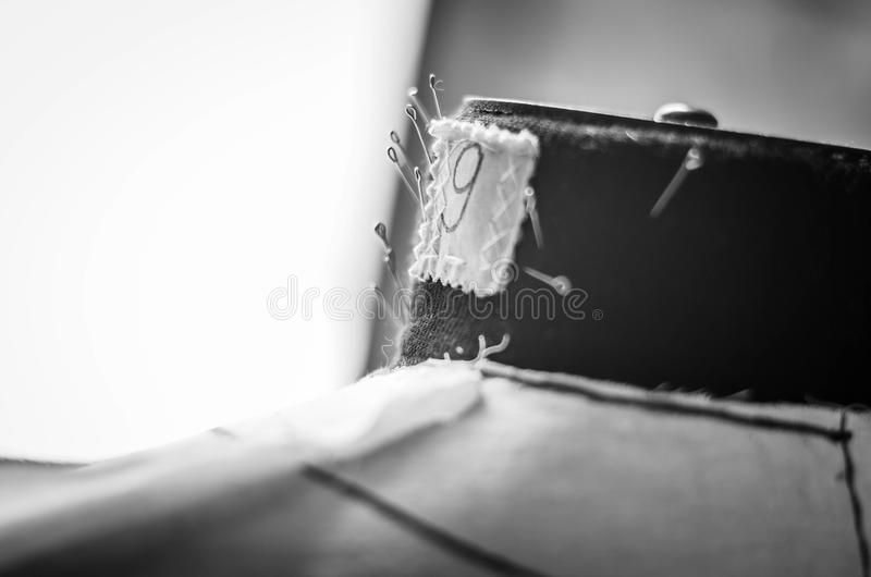 Tailors dummy with needles royalty free stock photo