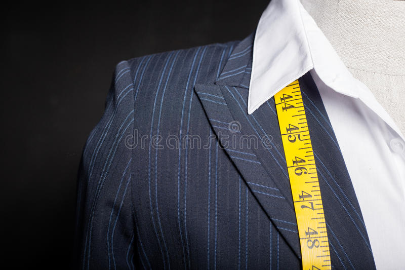 Tailors mannequin with measure tape royalty free stock photography