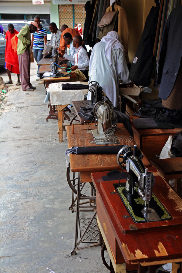 Tailors and Sewing Machines on an African Street royalty free stock photo