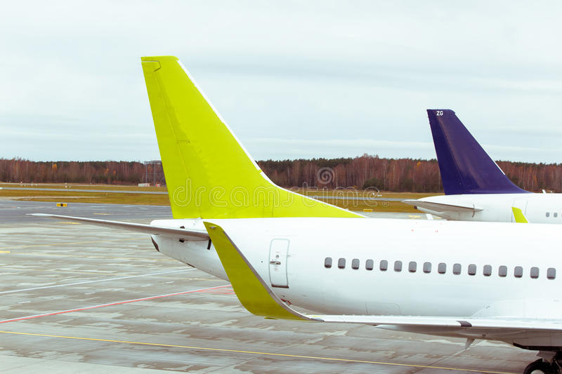 Tails of some airplanes at airport. Travel and transportation concepts. stock photo