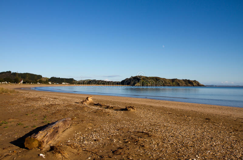 Taipa Beach, Northland, New Zealand. Taipa Beach on a still morning with clear blue skies, Doubtless Bay, Northland, New Zealand royalty free stock photos