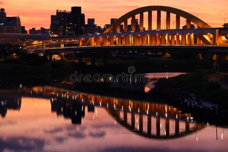 Taipei city sunset skyline. Songshan district sunset cityscape in Taipei. River skyline reflection royalty free stock photography
