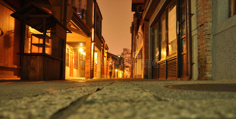 Taipei old city centre. Pedestrian street by night, floor perspective stock photos