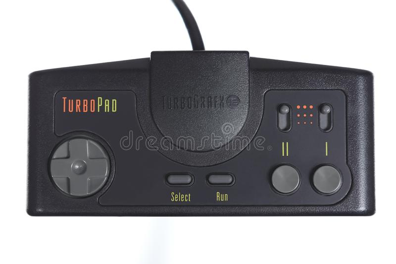 A Close-Up of the Nec TurboGrafx 16 Video Game Controller. Taipei, Taiwan - May 31, 2019: A floating Nec TurboGrafx 16 controller isolated on a white background royalty free stock image