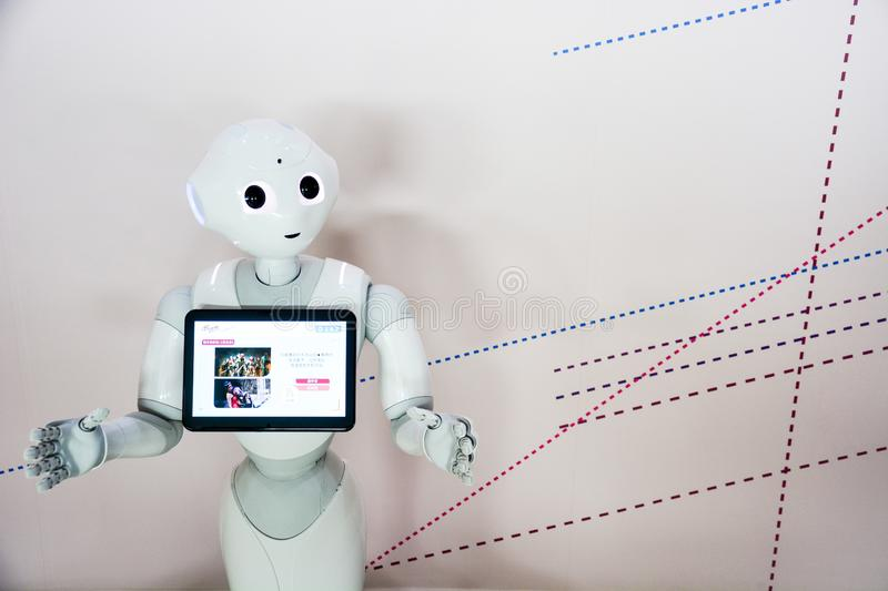 Taipei, Taiwan -  May 6, 2017 : `Pepper` robot assistant with information screen in duty to give information to audience stock photography