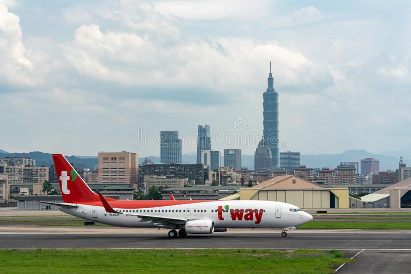 T`Way Airlines Boeing 737-800 taxing stock photography