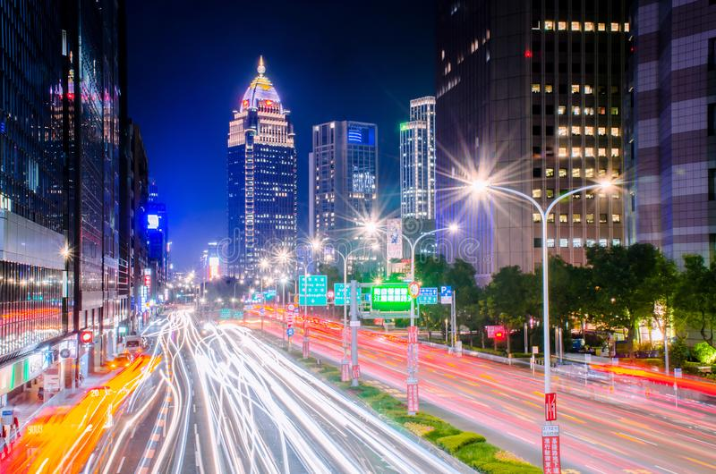 Traffic on Xinyi Road and view of Taipei at night, in Taipei, Taiwan royalty free stock image
