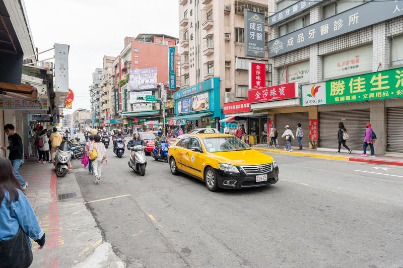 TAIPEI, TAIWAN - NOVEMBER 30, 2016: Taipei Street in one of suburb, district. Taxi Car and Scooters. royalty free stock images