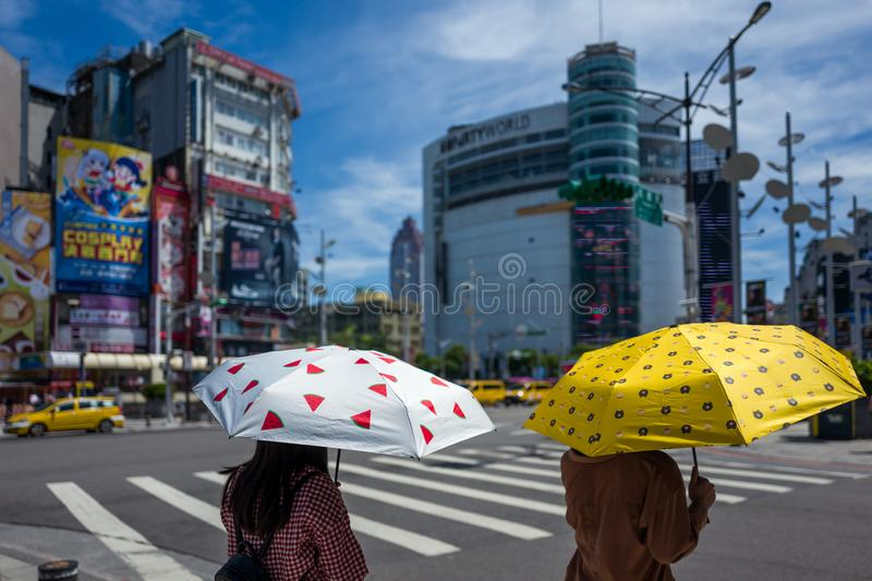 Taipei, Taiwan - September 18, 2018: Two girls with umbrellas protect themselves from the sun. stock image