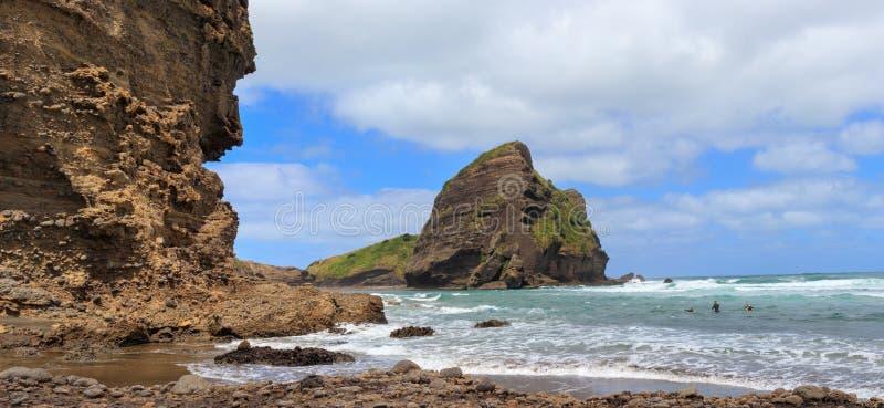Taitomo Island at Piha Beach panoramic view, New Zealand royalty free stock photo