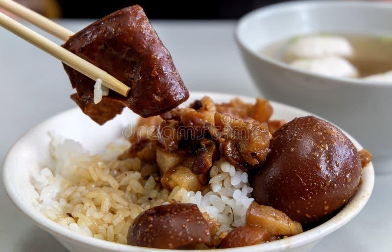 Taiwan famous food. Braised pork and fried tofu on rice. Soy-stewed pork rice, Taiwan Delicacies, Taiwan Street Food stock photography