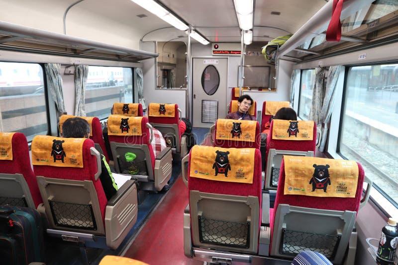 Taiwan Railways. HUALIEN, TAIWAN - NOVEMBER 26, 2018: People ride a Taiwan Railways (TRA) train in Taiwan. TRA carries more than 200 million passengers every stock photography