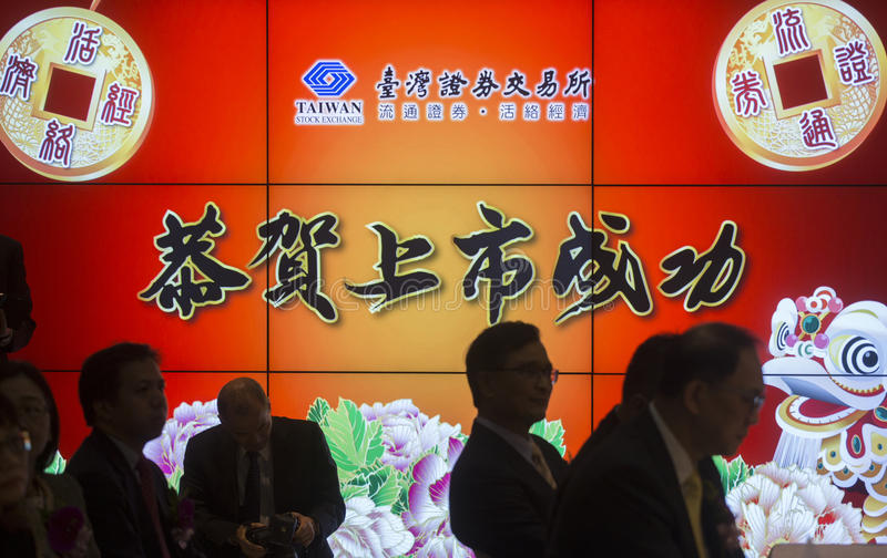 Taiwan stock exchange. A conference meeting launched in Taiwan stock exchange on Dec. 22, 2016. The Chinese characters on LCD mean to celebrate success of being stock images