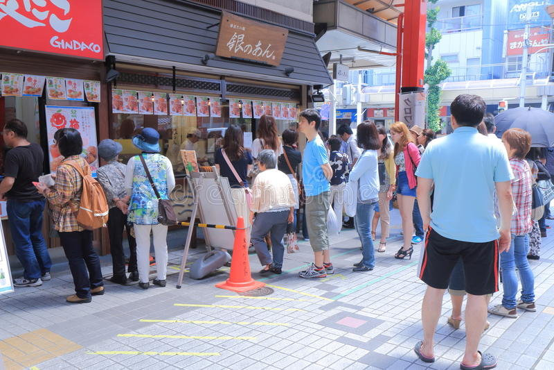 Popular restaurant Nagoya Japan. People queue to buy Taiyaki, at Osu Kannon Shopping arcade in Nagoya Japan royalty free stock photos