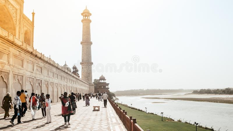 Taj Mahal, Agra, January 2019: Brilliant view of Taj Mahal and One of four pillars minarets from Back side of garden called stock image