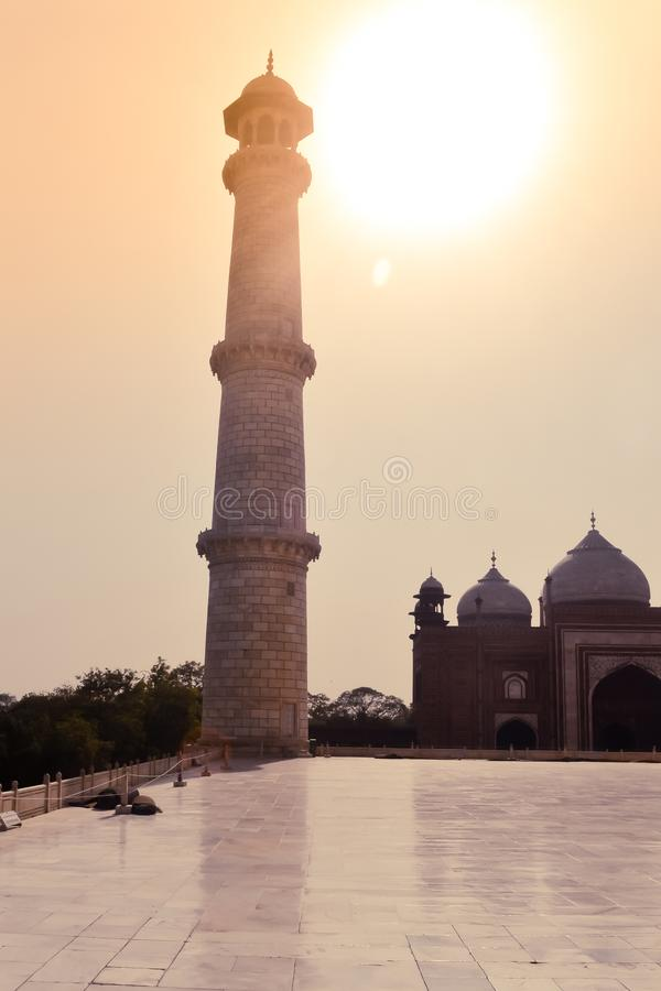 Taj Mahal, Agra, January 2019: One of the four pillars minarets of Taj Mahal a perfectly symmetrical building around main dome. Were built to slant away royalty free stock images