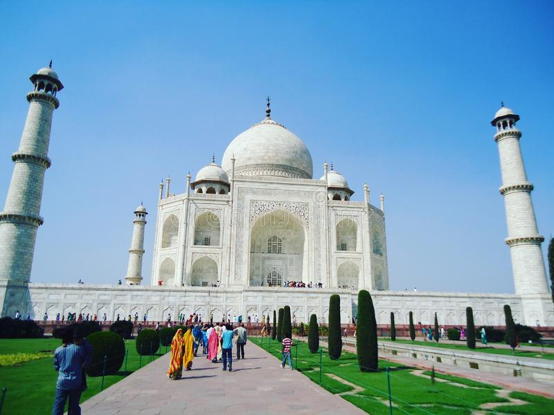 Taj Mahal. In Agra. One of the seven wonders of the world and an epitome of architectural brilliance of Mughal era in India. This monument is visited by large royalty free stock photos