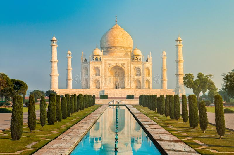 The Taj Mahal is an ivory-white marble mausoleum on the south bank of the Yamuna river in the Indian city of Agra, Uttar Pradesh. stock photo