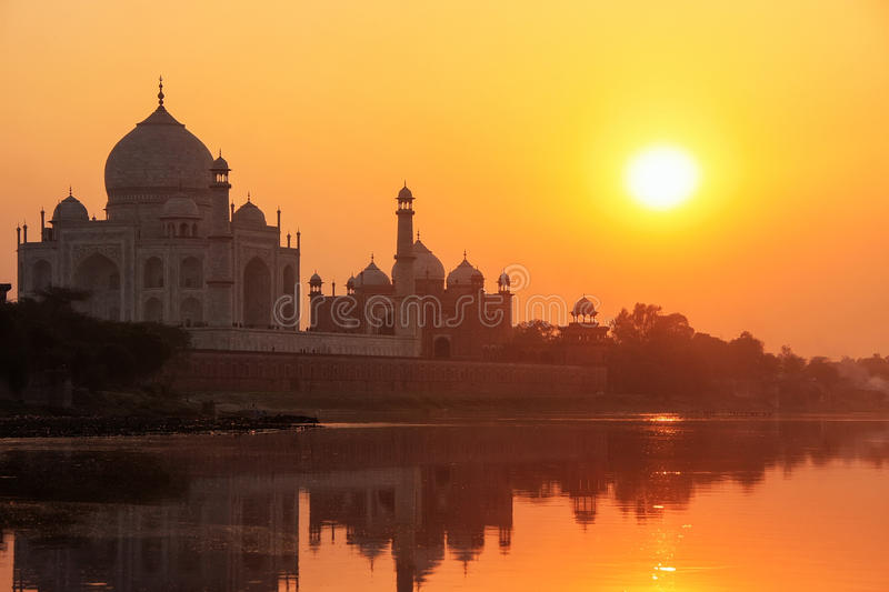 Taj Mahal reflected in Yamuna river at sunset in Agra, India royalty free stock image