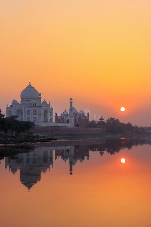 Taj Mahal reflected in Yamuna river at sunset in Agra, India royalty free stock photo