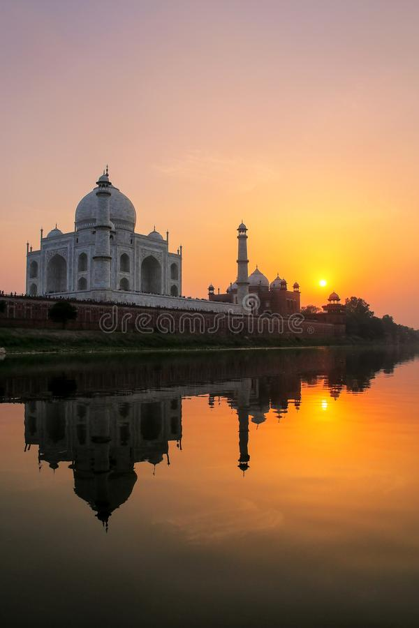 Taj Mahal reflected in Yamuna river at sunset in Agra, India stock photo