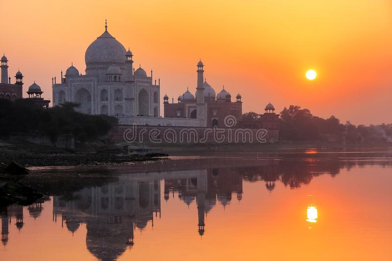 Taj Mahal reflected in Yamuna river at sunset in Agra, India stock photography