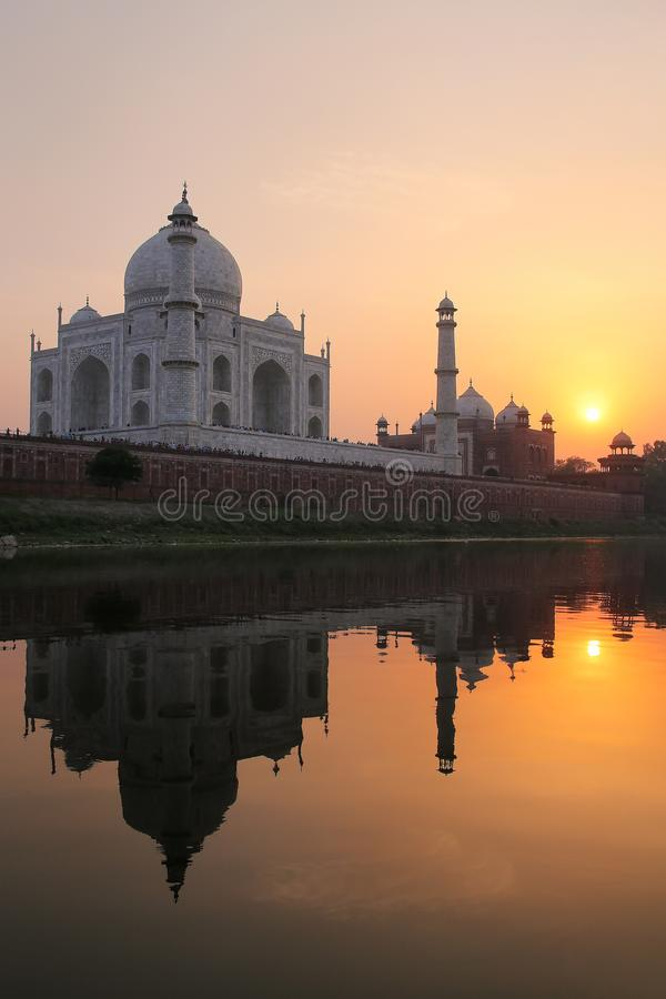 Taj Mahal reflected in Yamuna river at sunset in Agra, India stock image