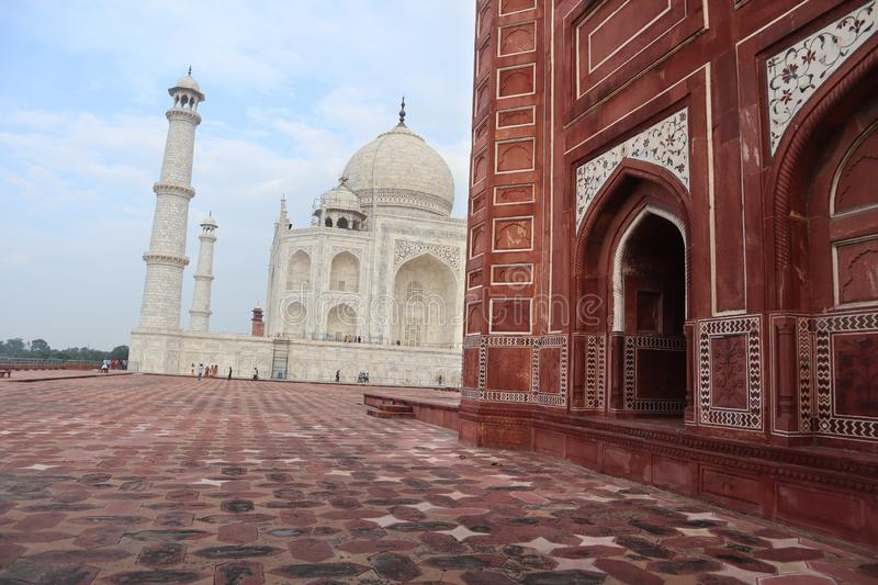 Taj Mahal is a white marble mausoleum on the bank of the Yamuna river in Agra city, Uttar Pradesh state - Image. Taj Mahal is a white marble mausoleum on the royalty free stock photo