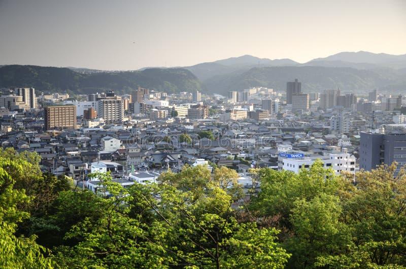 Tajimi city, Japan. Tajimi 多治見市 Tajimi-shi is a city located in Gifu prefecture, Japan. Aerial view on city with mountain on background and royalty free stock images