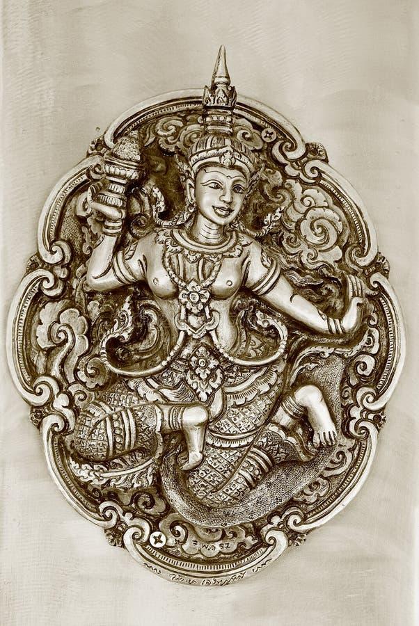 Tajlandzka czarodziejska reliefowa sztuki praca w sepiowym brzmieniu zdjęcia stock