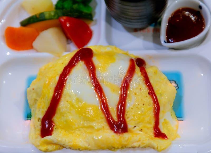 Tajlandzki omlet nad ryżowym menu ustawiającym dla dziecka obrazy stock
