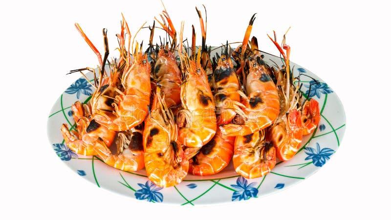 Tajlandzki owoce morza piec na grillu krewetki na naczyniu odizolowywającym na białym tle zdjęcia royalty free