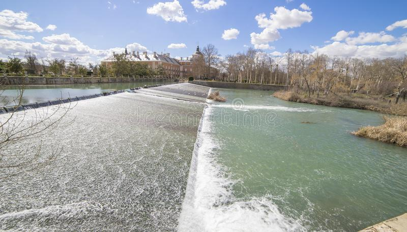 The Tajo River next to the Palace of Aranjuez. waterfalls with d stock image