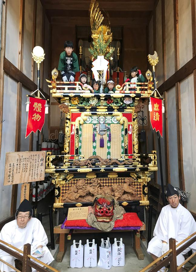 Takayama Festival Floats, Spring festival, Japan. Japanese children and adults in traditional national costumes sit on well decorated majestic floats getting royalty free stock photos