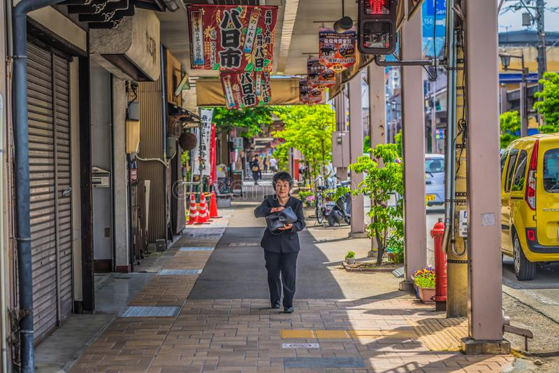 Takayama - May 26, 2019: Old lady in the streets of Takayama, Japan stock image