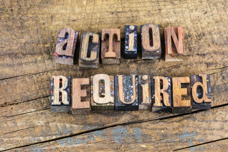 Take action required letterpress. Take action required positive success message weathered wood letterpress type sign encouragement typography royalty free stock photography