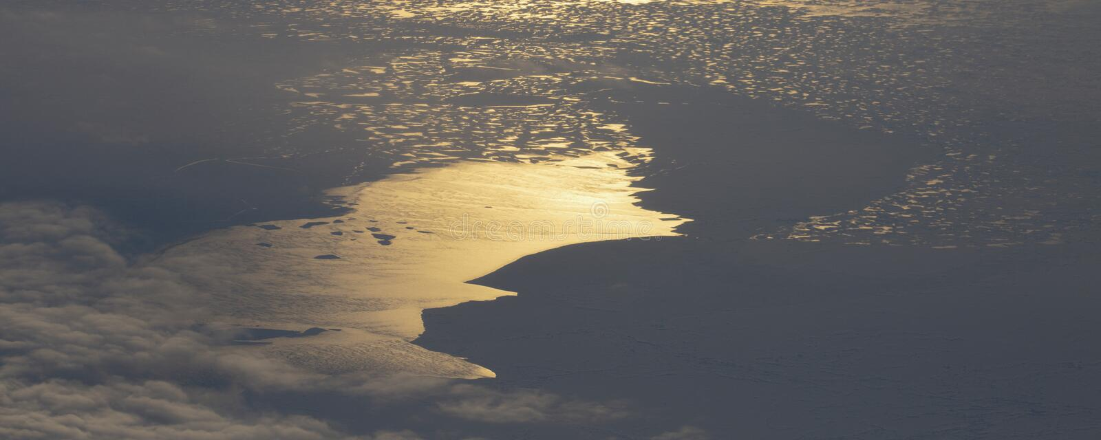 5Take an aerial view of the ice and sunrise over the bering strait.(1). The bering strait is located in the high latitudes, cold weather, many storms royalty free stock images