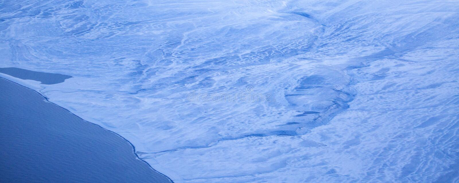 11Take an aerial view of the ice and sunrise over the bering strait.(1). The bering strait is located in the high latitudes, cold weather, many storms stock image