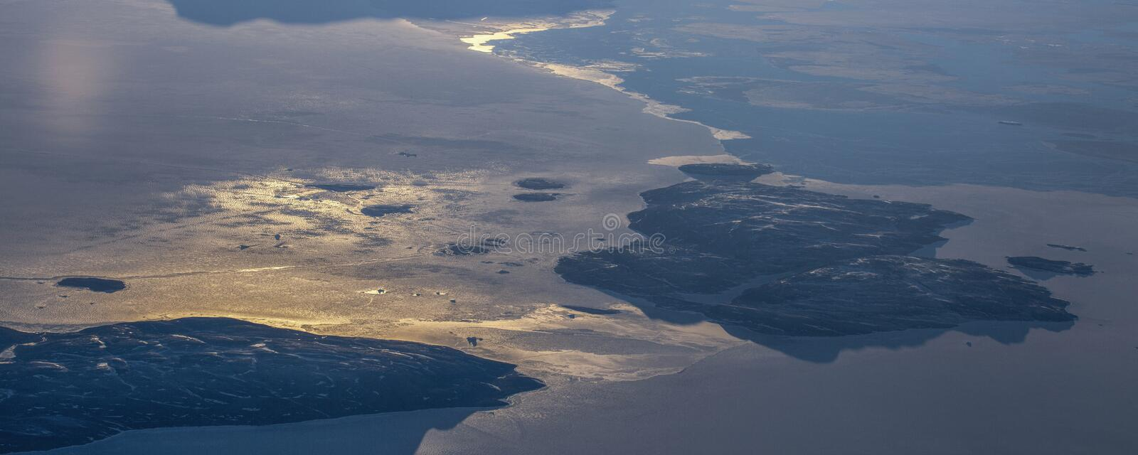 12Take an aerial view of the ice and sunrise over the bering strait.(1). The bering strait is located in the high latitudes, cold weather, many storms royalty free stock photos
