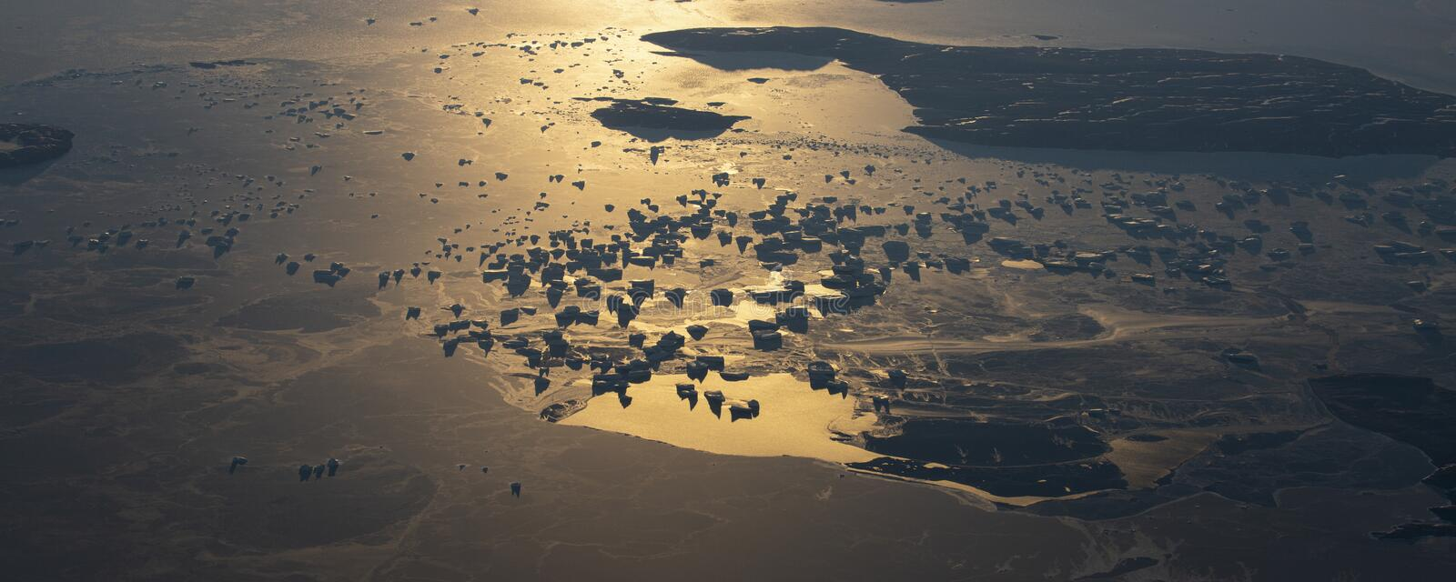 20Take an aerial view of the ice and sunrise over the bering strait.(1). The bering strait is located in the high latitudes, cold weather, many storms stock photography
