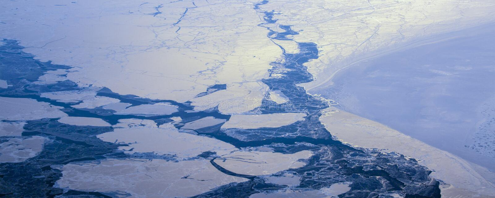 22Take an aerial view of the ice and sunrise over the bering strait.(1). The bering strait is located in the high latitudes, cold weather, many storms royalty free stock image