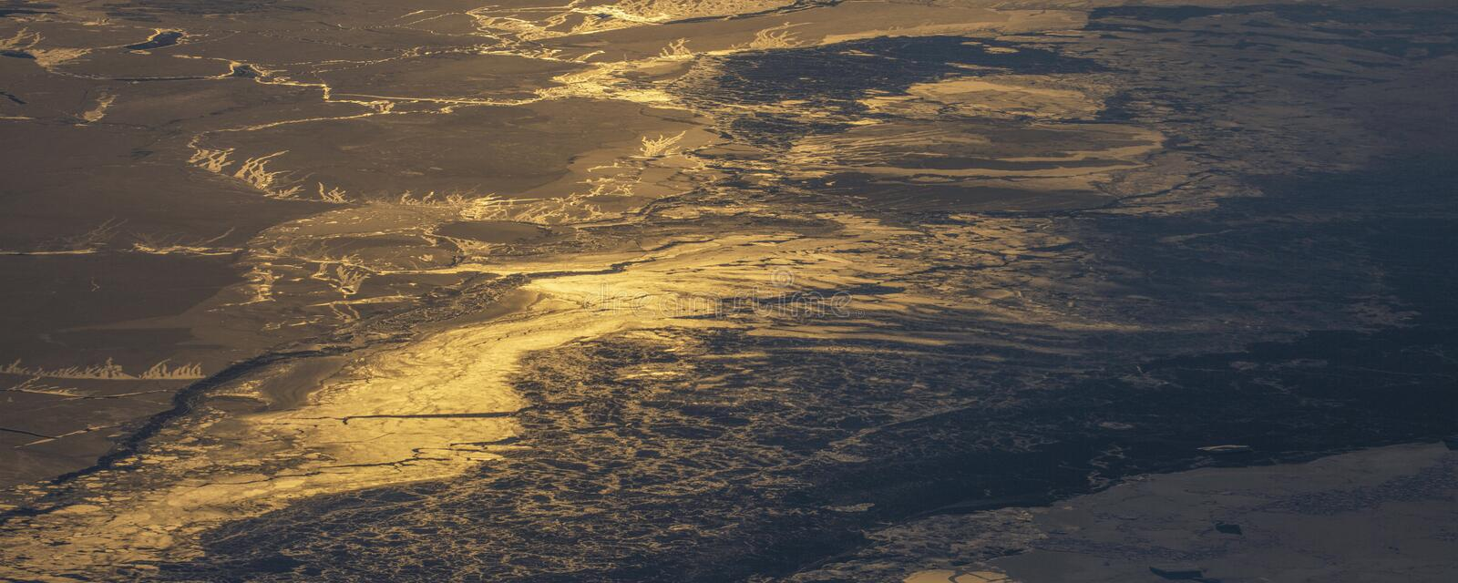 24Take an aerial view of the ice and sunrise over the bering strait.(1). The bering strait is located in the high latitudes, cold weather, many storms stock images