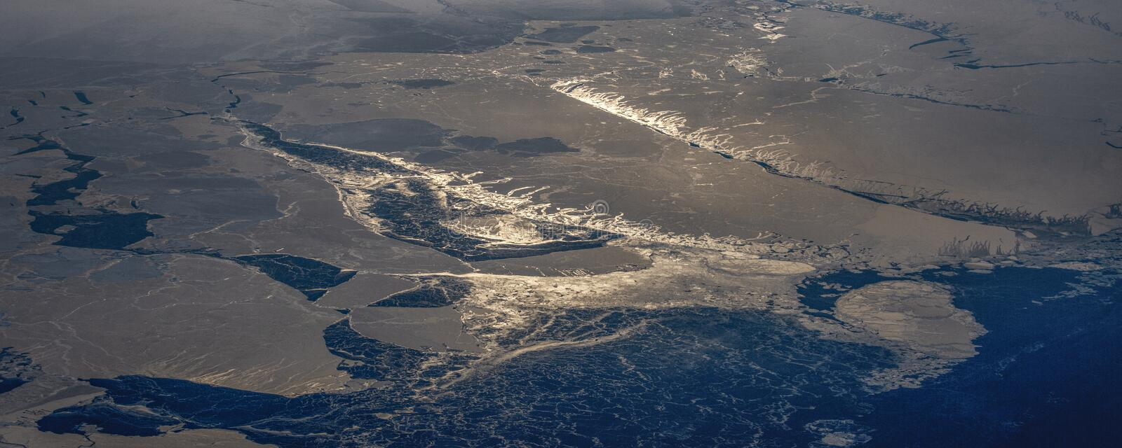 25Take an aerial view of the ice and sunrise over the bering strait.(1). The bering strait is located in the high latitudes, cold weather, many storms stock photography