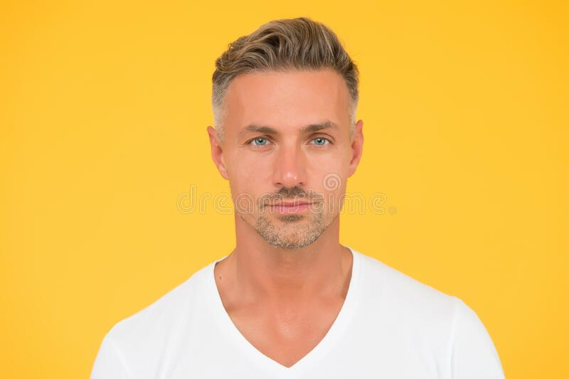Take ageing with respect. Man mature good looking model. Silver hair shampoo. Grizzle hair. Deal with gray roots. Man. Attractive well groomed facial hair royalty free stock images