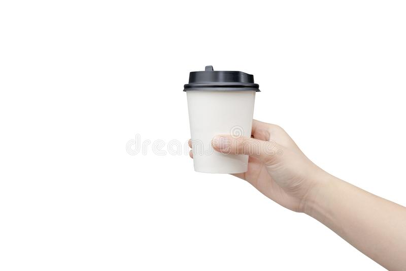 Take away coffee cup background. Female hand holding a coffee paper cup isolated on white background with clipping path. Close-up royalty free stock image