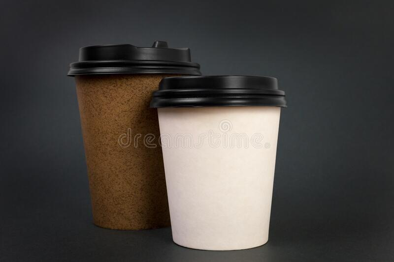 Take away coffee cups with lids on black background. Coffee to go concept. Take away coffee cups with lids on black background stock images