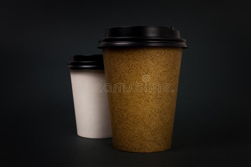 Take away coffee cups with lids on black background. Coffee to go concept stock photo