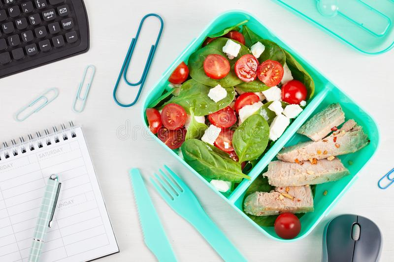 Take away lunch box with fresh salad and tuna fish over the offi stock photo