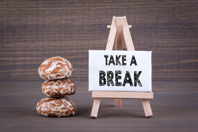 Take a break. Biscuits with sweet filling on a wooden background stock image