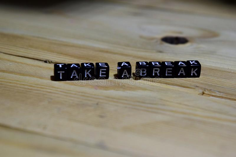 Take a break message written on wooden blocks. stock photos